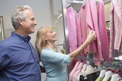 Senior Couple In Clothing Store Royalty Free Stock Photography