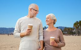 Senior couple with coffee cups over venice beach Stock Photography