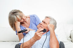 Senior couple competing at video Royalty Free Stock Image