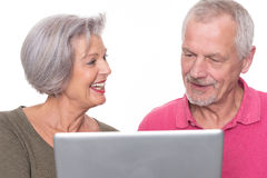 Senior couple with computer Stock Photography