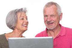 Senior couple with computer Royalty Free Stock Images