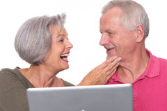 Senior couple with computer Stock Images