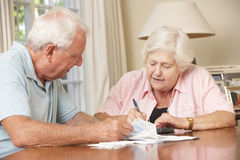 Senior Couple Concerned About Debt Going Through Bills Together Stock Photography