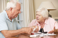 Senior Couple Concerned About Debt Going Through Bills Together Stock Photo