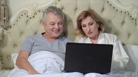 Senior couple connected with family on internet stock video