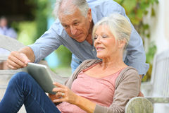 Senior couple connected on wifi with tablet Royalty Free Stock Photo