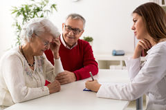 Senior couple on consultation with a doctor Royalty Free Stock Images