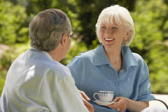 Senior Couple Conversing In Backyard Royalty Free Stock Photography