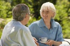 Senior Couple Conversing In Backyard Royalty Free Stock Photography