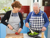 Senior couple cooking. At their kitchen at home Royalty Free Stock Images