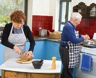 Senior couple cooking. At their kitchen at home Stock Image