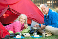 Senior Couple Cooking Breakfast On Camping Holiday Royalty Free Stock Photography