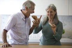 Senior couple cooking Stock Image
