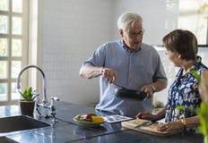 Senior Couple Cooking Food Kitchen Royalty Free Stock Photos