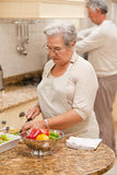 Senior couple cooking in the kitchen Royalty Free Stock Photography