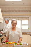 Senior couple cooking in the kitchen Royalty Free Stock Image