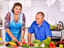 Senior couple cooking at kitchen Stock Photo