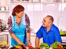Senior couple cooking at kitchen Stock Photos