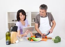 Senior couple cooking lunch at home Stock Image