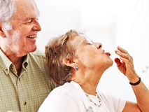 Senior couple cooking together royalty free stock images