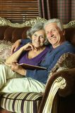 Senior couple on the couch Royalty Free Stock Image