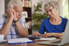 Senior couple counting the bills Stock Images
