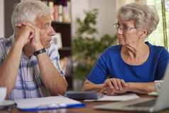 Senior couple counting the bills Stock Image