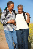 Senior couple on country hike. Smiling Stock Photo