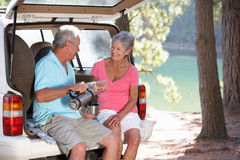 Senior couple on country picnic. Smiling at one another Royalty Free Stock Photo