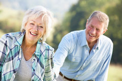 Senior couple on country walk Royalty Free Stock Photos