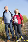 Senior couple on country walk Royalty Free Stock Photo