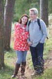 Senior Couple On Country Walk Through Woodland Royalty Free Stock Photos