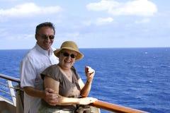 Senior couple on cruise. Happy attractive senior couple on cruise ship Stock Photos