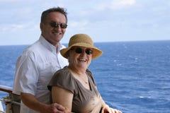 Senior couple on cruise. Happy attractive senior couple on cruise ship Stock Image