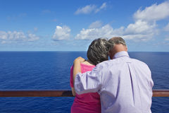 Senior Couple on a Cruise Vacation. A senior couple enjoying a cruise vacation together on the deck of a ship Stock Images