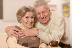 Senior couple with cup of tea Royalty Free Stock Image