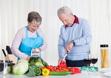 Senior couple cutting vegetables Royalty Free Stock Image