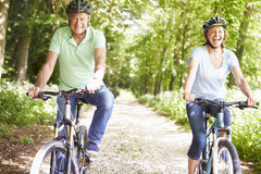 Senior Couple On Cycle Ride In Countryside Royalty Free Stock Image