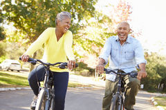 Senior Couple On Cycle Ride In Countryside Stock Images