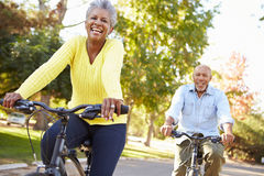 Senior Couple On Cycle Ride In Countryside. Smiling Royalty Free Stock Photo