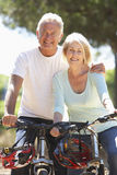 Senior Couple On Cycle Ride Together Stock Images