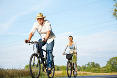 Senior couple cycling with bikes Royalty Free Stock Images
