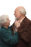 Senior couple dancing. Man man holding woman's hand, isolated on white background Stock Images