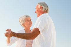 Senior couple dancing on the beach Stock Image
