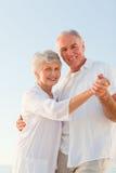 Senior couple dancing on the beach Royalty Free Stock Photos