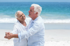 Senior couple dancing at the beach Royalty Free Stock Images