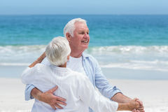 Senior couple dancing at the beach Stock Photography