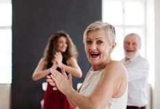 Senior couple in dancing class with dance teacher. stock image