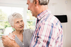 Senior couple dancing at home Stock Images