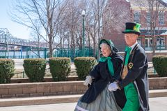 Senior couple dancing in St. Patrick`s Day parade stock photography